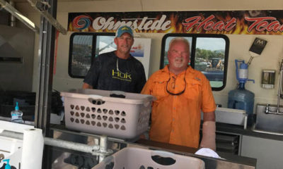 Cpt. Steve and Cpt. C.R. Maher at fishing tournament - Weighmaster
